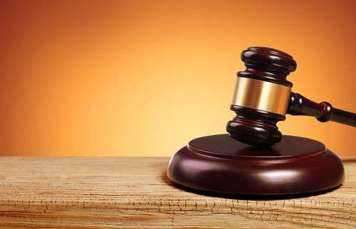 gavel with orange background